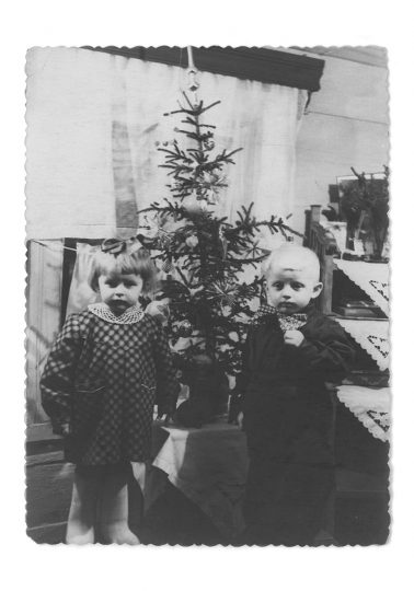 My mum and uncle, both twins, by the Christmas tree on the Proletarian street 39 in Igarka, Russia / From the series Motherland. Far Beyond the Polar Circle, 1954, Flatbed scan from the original